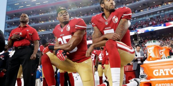 Image of Football Players kneeling during America's National Anthem out of protest.